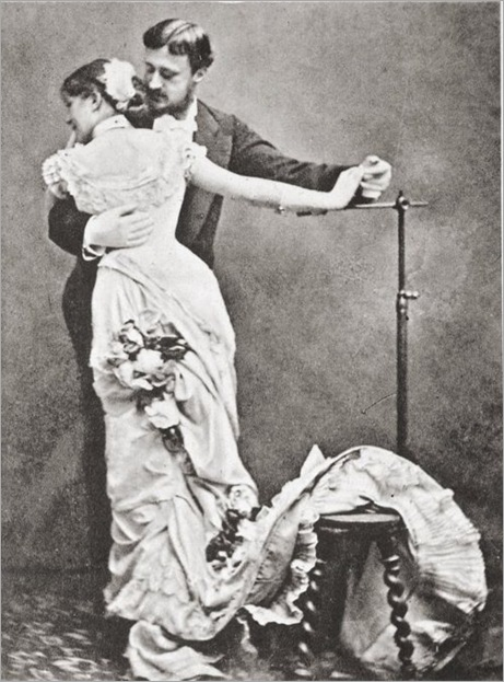 Photographer dancing with his model. France, c.1880