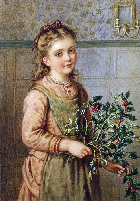 Girl holding holly and mistletoe